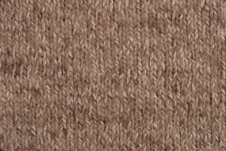 animal origin: Textural image. Closeup of woolen machine-knitted fabric.