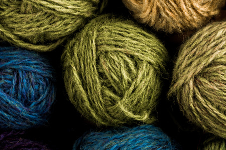 gomitoli di lana: Many small balls of wool of rainbow colors in busket.