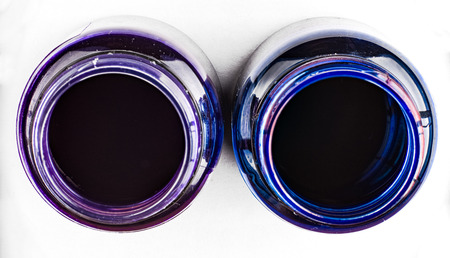 suffusion: Deep blue and purple ink bottles. Top view.
