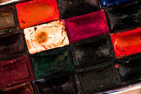 suffusion: Part of box of water colours. Top view.