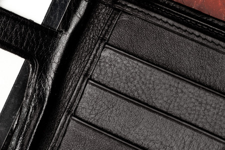animal origin: Part of opened black leather porte-monnaie with many pockets.