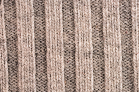 textural: Textural image. Closeup of woolen machine-knitted fabric.