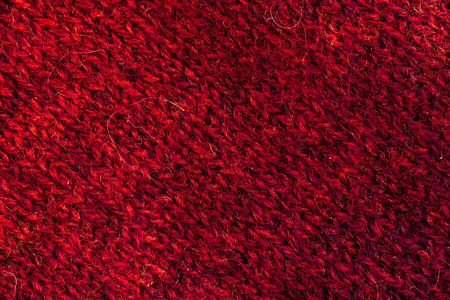 animal origin: Textural image. Closeup of bright-coloured woolen hand-knitted fabric.