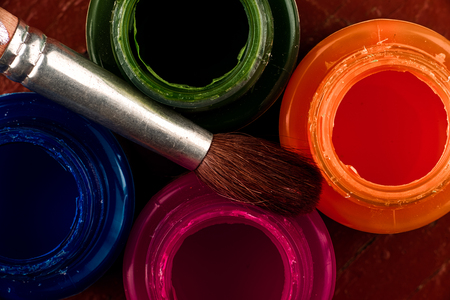 suffusion: Jars of glass paints and brush. Top view. Stock Photo