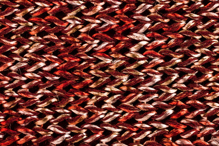 hosiery: Textural image. Closeup of melange copper hand-knitted fabric.