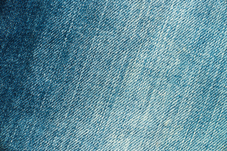 textural: Textural image. Fragment of light blue jeans. Stock Photo