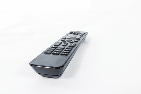 clicker: Close-up of remote controller on a white background.