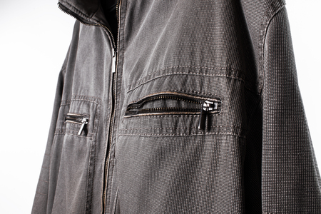 over white: Details of male jacket. Closeup over white background.