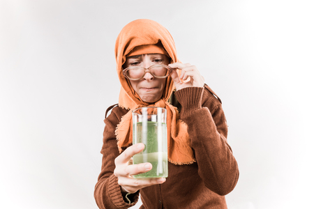 grotesque: Grotesque grandmother character wearing big glasses and babushka on white background.