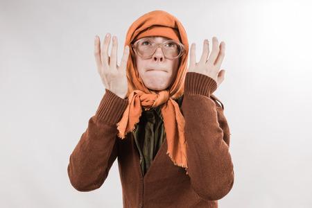sudarium: Grotesque grandmother character wearing big glasses and babushka on white background.