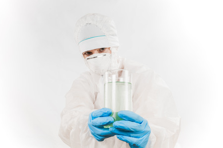 infective: Female professional in hooded suit for bio-hazard protection over white background.
