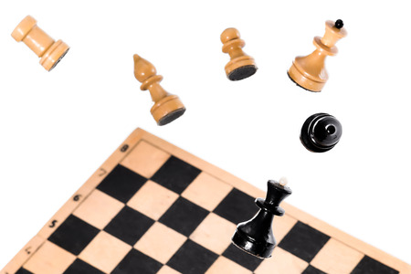 pawn to king: Chess pieses over the flying chess board. Isolated image on white background.