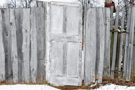 abandonment: The gate of old fence made of scrap materials. Stock Photo
