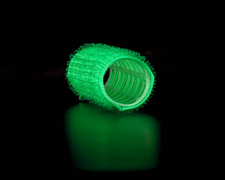 velcro: Abstract composition of the close-up sticky hair curlers in bright colors . Stock Photo