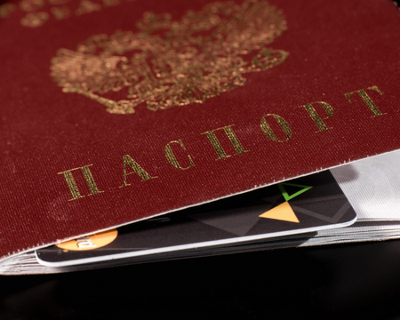 naturalization: Close-up of a Russian passport cover with a plastic card embedded in it . Text on Russian: PASSPORT. Stock Photo