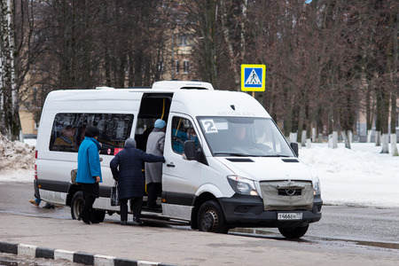 public transport: Lytkarino, Moscow region, Russia - March 8, 2016: Passengers get on the bus at the bus stop.