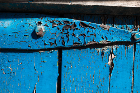 worn structure: Detail of the exterior of an old wooden painted house.