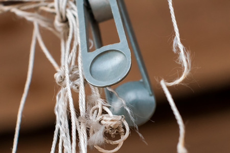 dilapidated: Closeup picture. Detail of old  dilapidated clothesline. Stock Photo