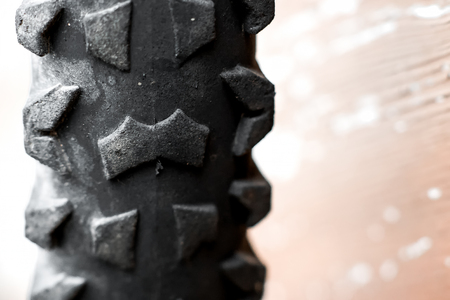 tyre tread: Detail of spare bicycle tire hanging on the wall.
