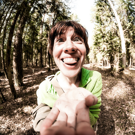 showed: Spherized face with showed tongue on the forest background. Stock Photo