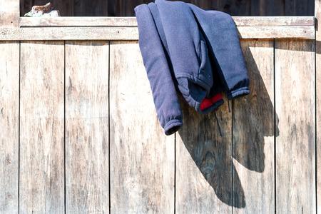parapet: Fleece vest left of the wooden parapet.