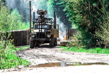 logging truck: Logging truck standing on the road near the sawmill. Stock Photo