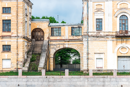 parapet wall: Bolshoy Prospekt of Petrograd Side, 1. Yellow facade of historical building with stairs and arch. 1920 years. St. Petersburg, Russia
