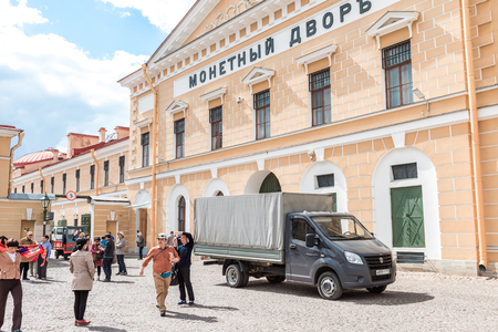 sightseeng: St.Petersburg, Russia - May 17, 2016: tourists on Peter and Paul fortress area sightseeng on exscurcion.