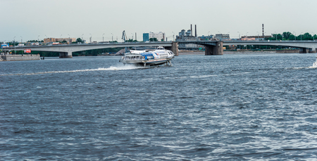 nevsky: St.Petersburg, Russia - May 20, 2016: passenger boat floating by Neva river. View to Alexander Nevsky bridge.