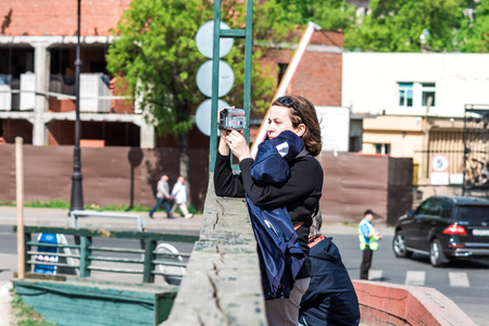 taking video: St.Petersburg, Russia - May 17, 2016: tourist woman on Peter and Paul fortress area taking video.