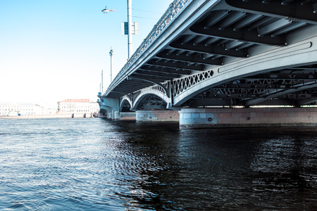 embankment: Blagoveshchensky (Leuteinant Schmidt) bridge over Neva river in St.Petersburg, Russia. Closeup view from English embankment.