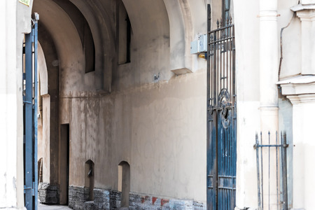 wideview: Entrance arch of well courtyard in St. Petersburg, Russia. Old architecture.