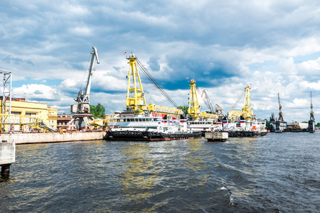 neva: St.Petersburg, Russia - May 17, 2016: Working process at Malaya Neva river port. Editorial