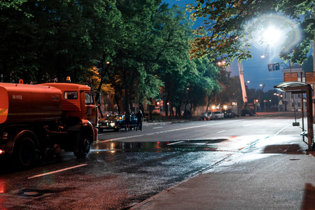 film crew: St. Petersburg, Russia - May 20, 2016: Film crew making a scene with car and street sweeper on location at the Konnogvardeysky boulevard on the night.