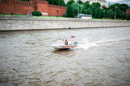 parapet wall: Moscow, Russia - June 5, 2016: Emergency service motor boat on Moskva river.