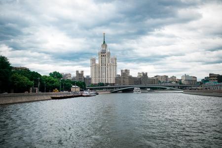 kotelnicheskaya embankment: Moscow, Russia - June 5, 2016: One of Stalin skyscrapers - the house on Kotelnicheskaya Embankment. Big Ustyinsky bridge.