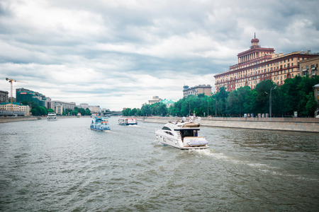 residental: Moscow, Russia - June 5, 2016: Historical residental building on Kosmodamianskaya embankment. Touristic ships. Editorial