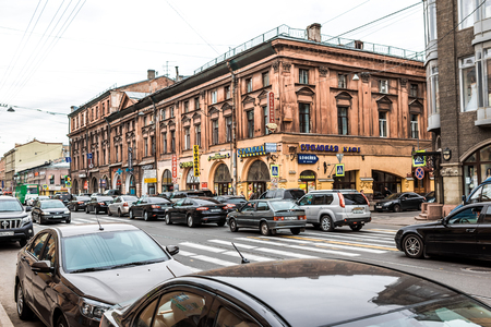 simple life: St. Petersburg, Russia - May 18, 2016: Everyday life of natives and tourists. Simple pedestrians, cars and passengers among unique architecture.