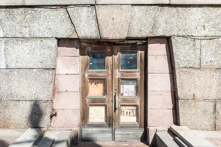 tilt views: Architectural details of old apartment building, St. Petersburg, Russia.