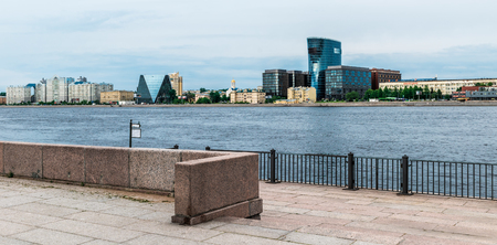 peterburg: St.Petersburg, Russia - May 20, 2016: building of business center Plaza St. Petersburg on Malookhtinsky Avenue. Long-rage view from Sinopskaya embankment.