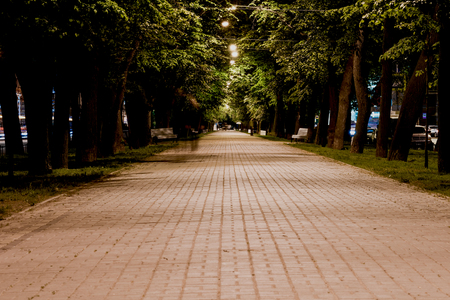 nightview: Nightview of Konnogvardeisky Boulevard with bright light at the end, St. Petersburg, Russia.