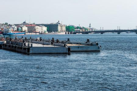 blagoveshchensky: St.Petersburg, Russia - May 16, 2016: Blagoveshchensky bridge and Leuteinant Schmidt embankment over Neva river. Pier on the foreground.