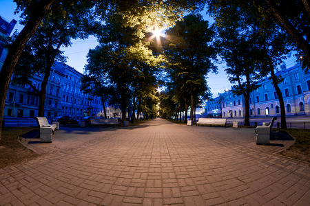 boulevard: Nightview of Konnogvardeisky Boulevard with bright light at the end, St. Petersburg, Russia.