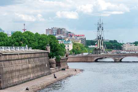 excursion: St.Petersburg, Russia - May 17, 2016: tourists on Peter and Paul fortress area crossing bridge on excursion. Editorial