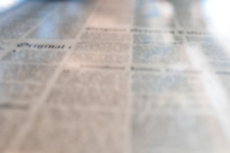 old newspaper: Textural image of old newspaper under the glass on the table.