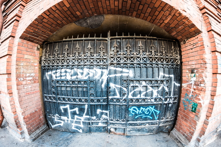 wideview: St.Petersburg, Russia - May 17, 2016: Wide view of metal gate covered with graffiti.