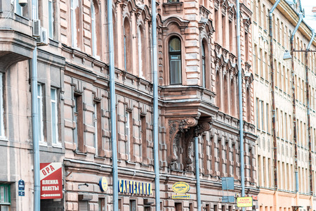 tilt views: St.Petersburg, Russia - May 19, 2016: Vasilyevsky island. Architectural details of old apartment building, St. Petersburg, Russia.