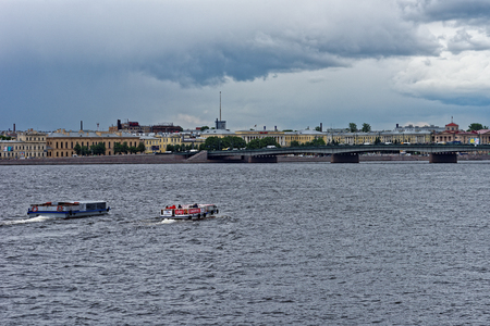 neva: St.Petersburg, Russia - June 10, 2016: Passenger boats floating by Neva river. View to Liteyniy bridge.