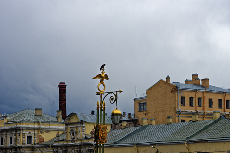 street lantern: St.Petersburg historical street lantern over cloudy sky background.