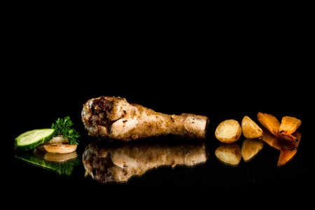 drumstick: Roasted chicken drumstick and vegetables on the black background Stock Photo